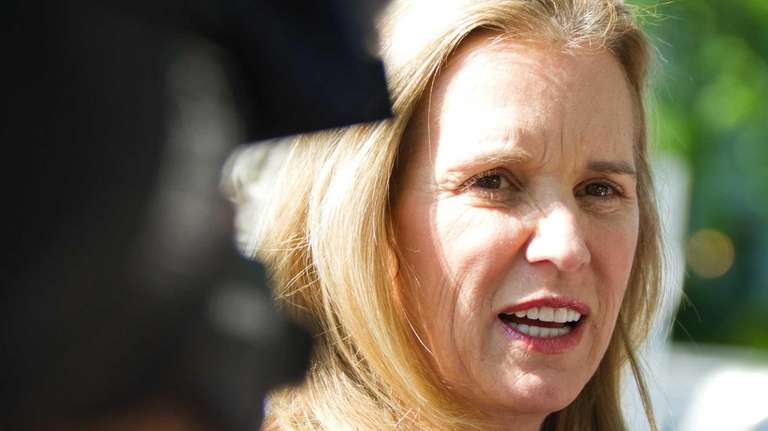 Kerry Kennedy speaks to the media before the