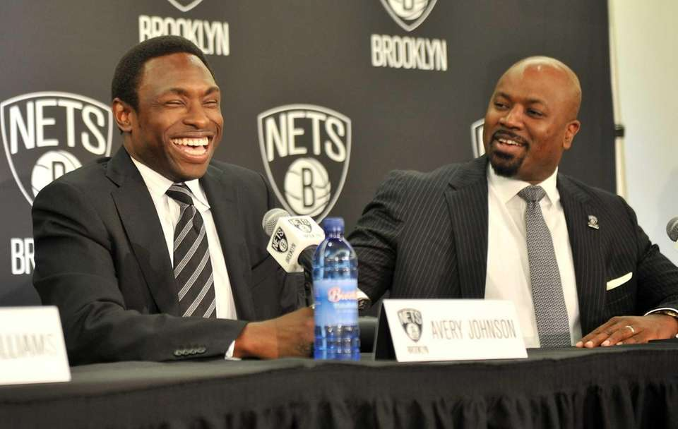 Brooklyn Nets head coach Avery Johnson, left, and