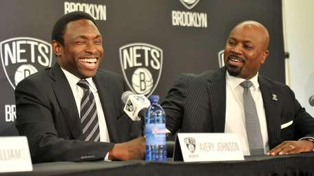 Brooklyn Nets head coach Avery Johnson, left, and