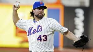 R.A. Dickey delivers a pitch during the first
