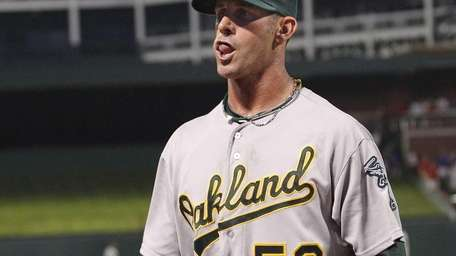 Oakland Athletics pitcher Grant Balfour walks to the