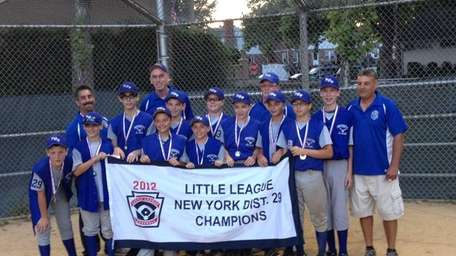 New Hyde Park 12-year-olds hold their championship banner