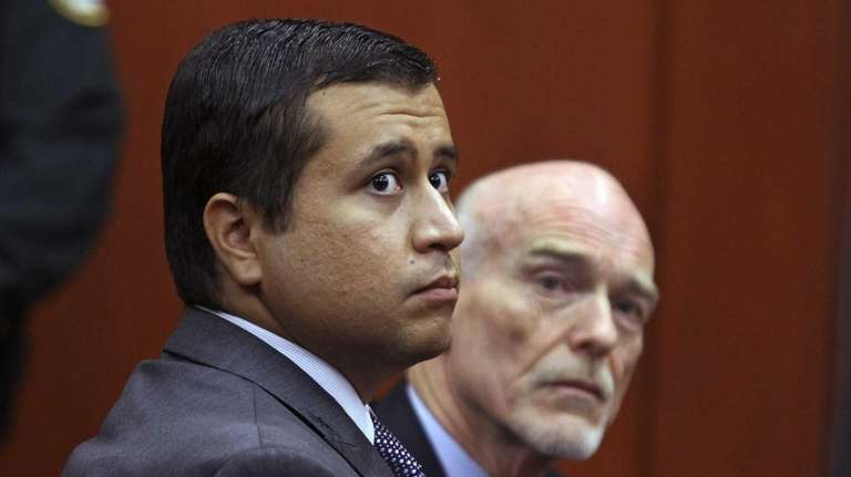 In this file photo, George Zimmerman, left, and
