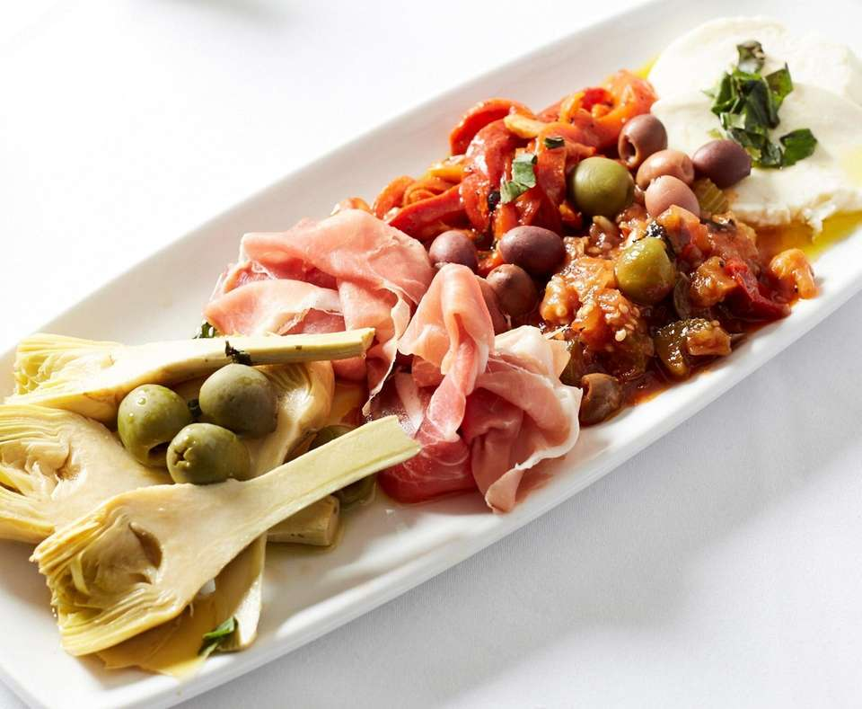 Antipasto freddo is elevated by stem-on artichokes, housemade