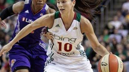 Seattle's Sue Bird dribbles past Phoenix's Temeka Johnson