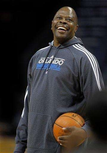 Orlando Magic assistant coach Patrick Ewing laughs during