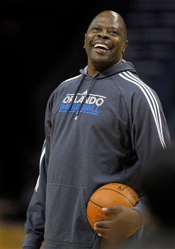 Orlando Magic assistant coach Patrick Ewing laughs during