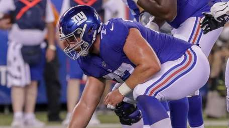 Giants center Spencer Pulley lines up over the