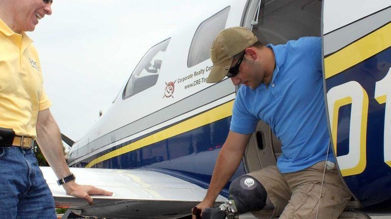 Jessie Fletcher, 23, exits the plane belonging to
