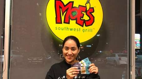 Newsday reporter Daysi Calavia-Robertson shows off coupons she