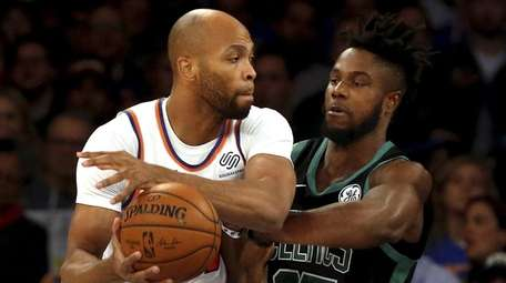 Taj Gibson of the Knicks battles for the