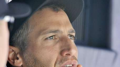 Andy Pettitte watches from the dugout. (July 15,