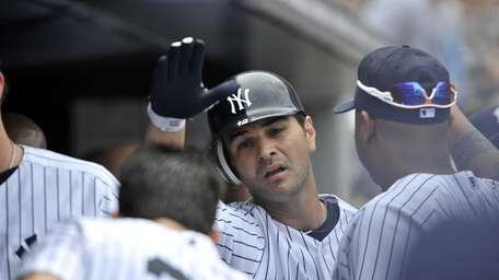 Eric Chavez in the Yankees dugout after hitting
