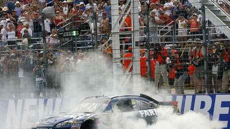 Kasey Kahne performs a burnout after winning the