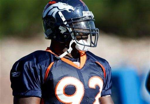 Denver Broncos defensive end Elvis Dumervil looks on