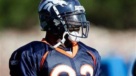 Denver Broncos defensive end Elvis Dumervil looks on