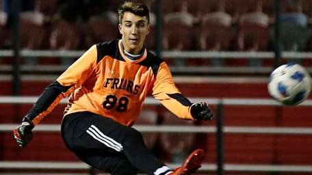 Christian Micheli goalie of Saint Anthony's passes the