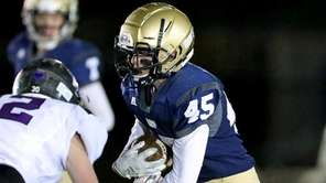 Bayport WR Zach Kroog runs through midfield against