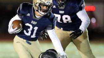 Bayport RB Ethan Trotta carries the ball for
