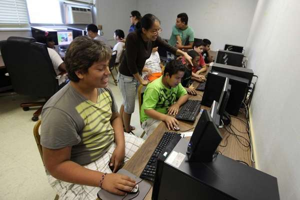 Children use the computer lab as part of