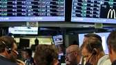 Traders work as the New York Stock Exchange