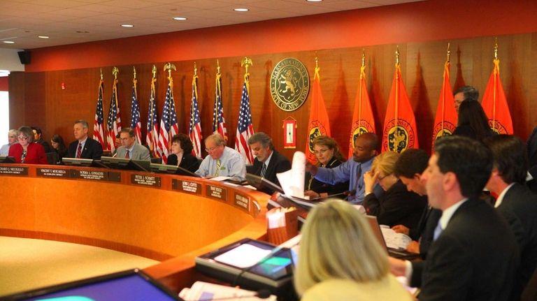 Members of the Nassau County Legislature argue about