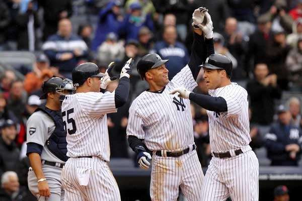 Mark Teixeira #25 celebrates with Derek Jeter #2