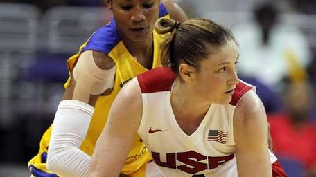Team USA guard Lindsay Whalen, front, looks to