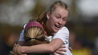 Lakin Ciampo of Shoreham-Wading River is congratulated by