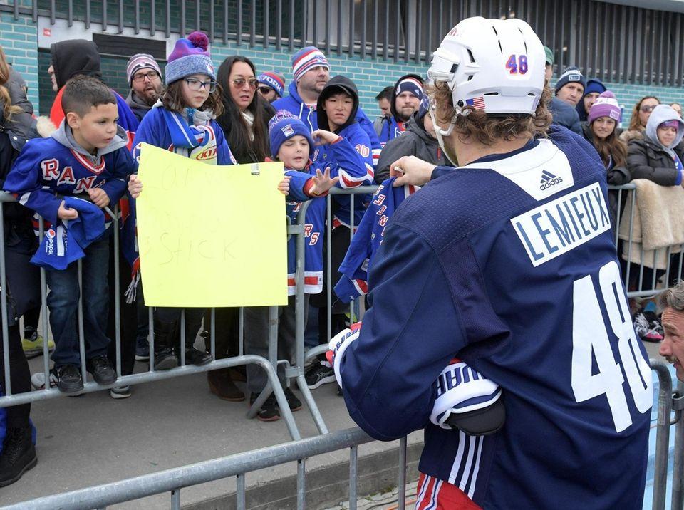 Brendan Lemieux of the NY Rangers signing jerseys