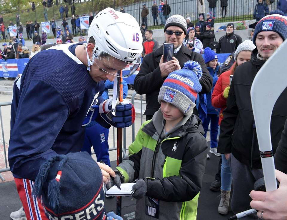 Ryan Strome of the NY Rangers signing autograph