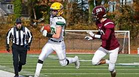 Jack Rogers #80 of Lynbrook runs the ball