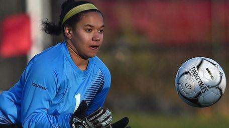 Emma Ward, Babylon goalie, makes a save during