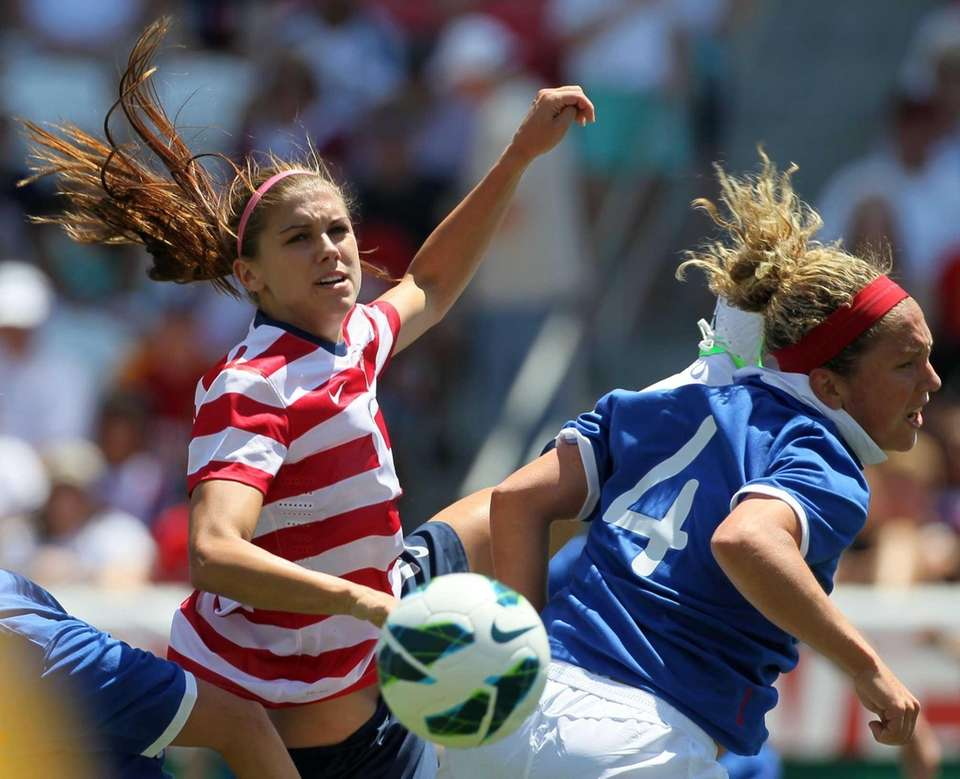 USA forward Alex Morgan, left, and Canada defender