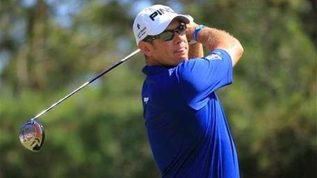Lee Westwood of England hits from the ninth