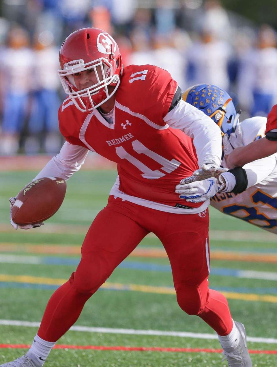 East Islip's Anthony Carroll (11) catches a pass