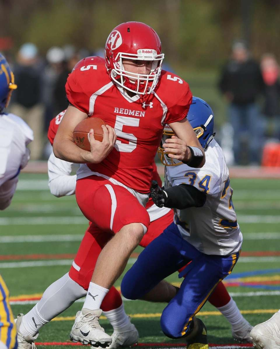 East Islip's Brandon Miller (5) runs in a