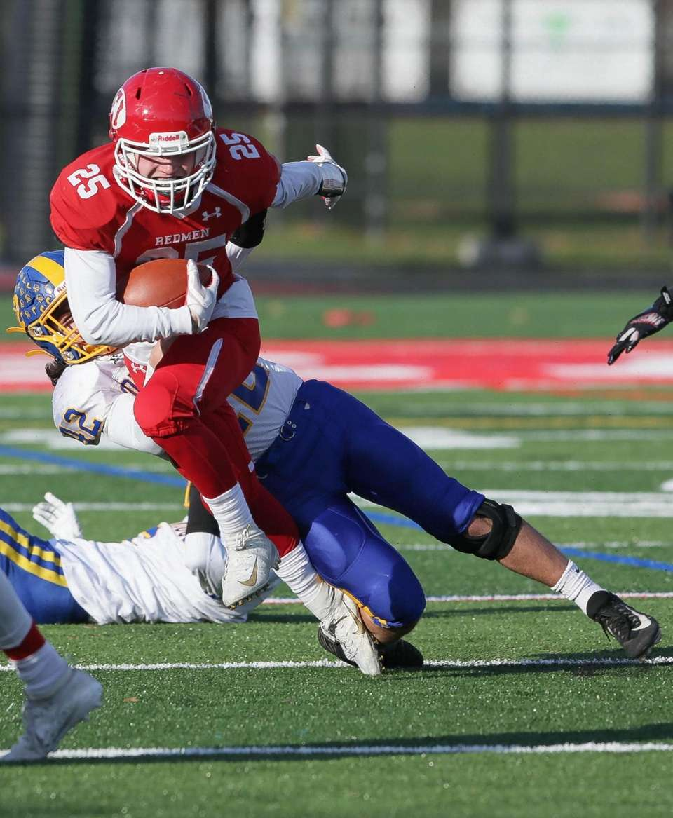 East Islip's Troy Burrell (25) runs the ball