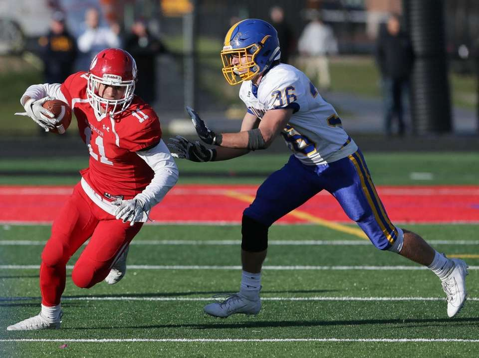 East Islip's Anthony Carroll (11) makes a catch