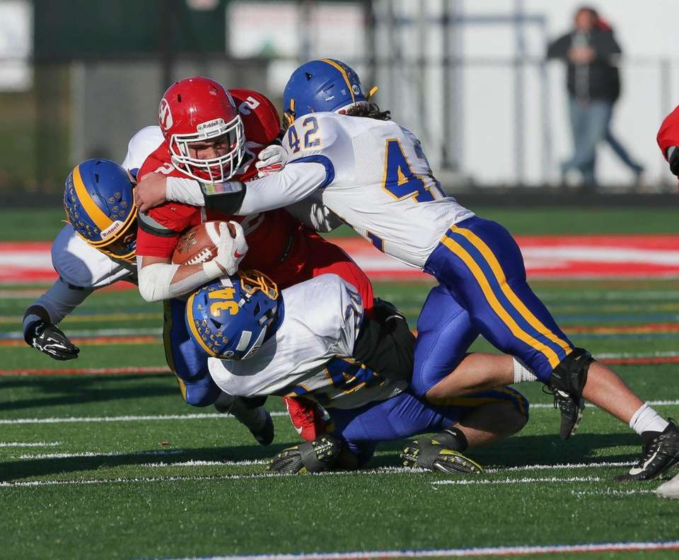 East Islip's Dylan Rigo (2) runs the ball