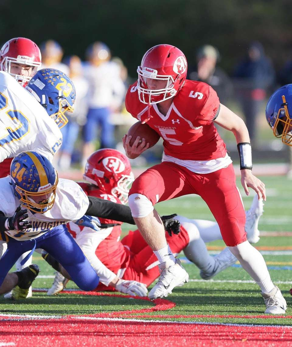 East Islip's Brandon Miller (5) runs in the