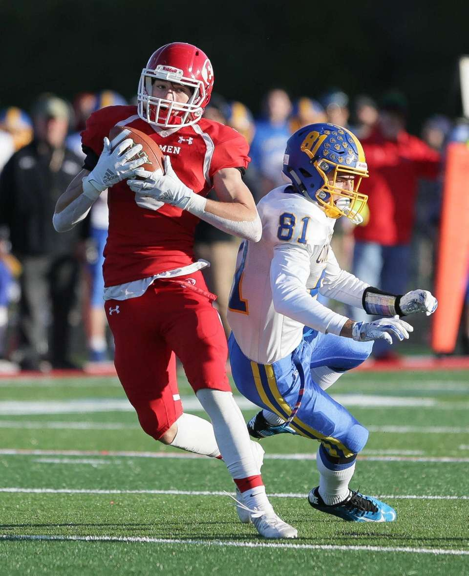 East Islip's Rob Kreush (3) pulls in a
