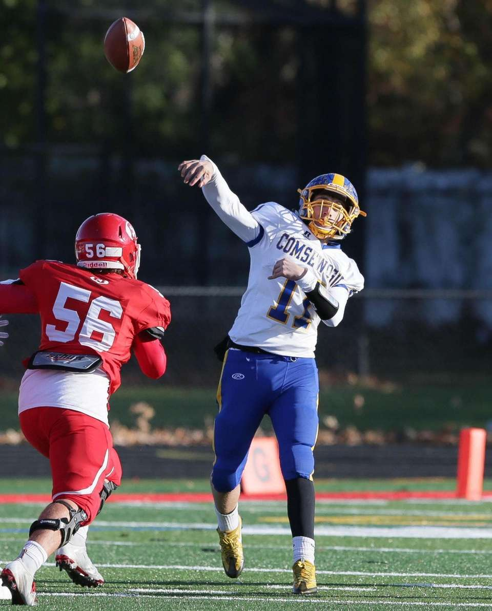 Comsewogue's Brady Shannon (11) throws a pass in