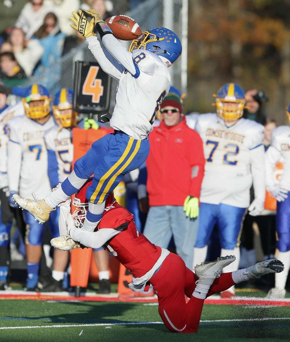 Comsewogue's Anthony Cambria (81) goes up for the