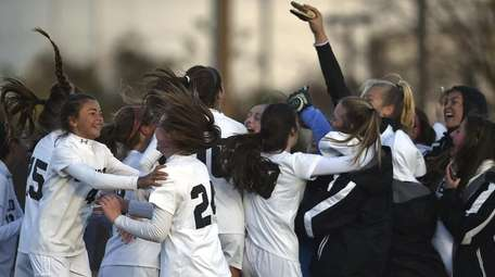 Babylon teammates celebrate after their 2-1 win over