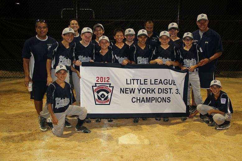 Plainview 12-year-olds hold their championship banner after winning