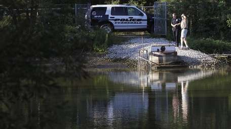 Authorities monitor Meyers Lake as the lake drains