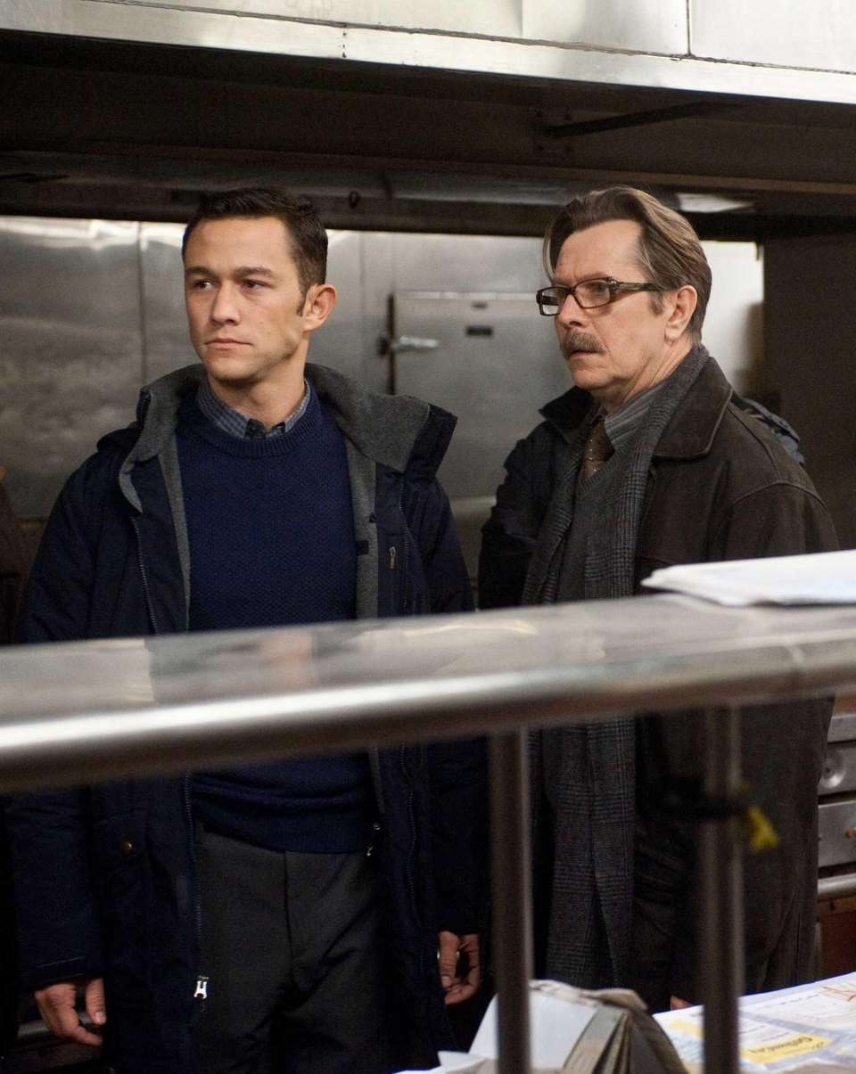 Joseph Gordon-Levitt as John Blake, left, and Gary