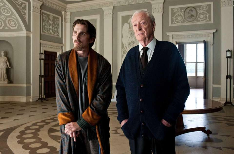 Christian Bale as Bruce Wayne, left, and Michael