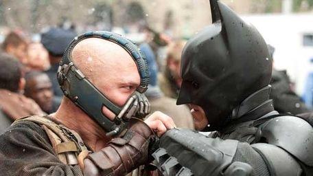 Tom Hardy as Bane and Christian Bale as